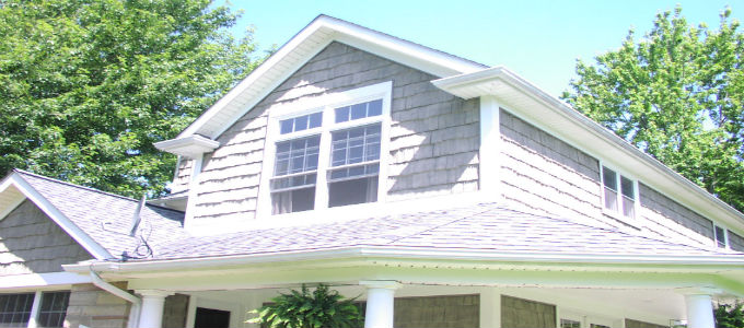 Beautiful house with a new roof, sidings, and windows installed.